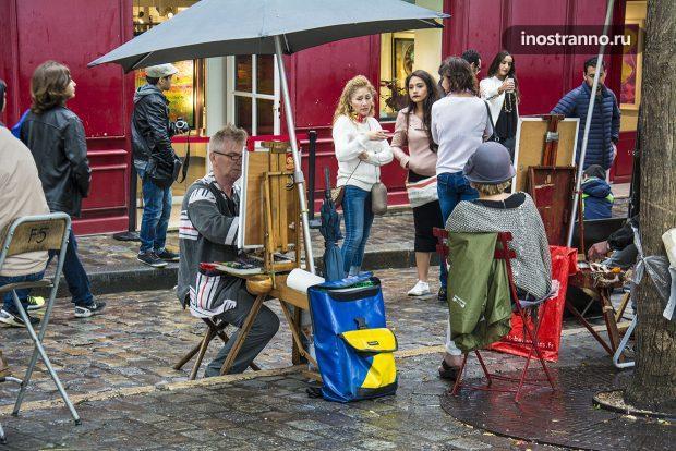 Художник в Париже на Монмартр